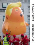 London, United Kingdom, 13th July 2018: The Trump baby balloon in Trafalgar square during an Anti Trump rally in Central London - stock photo
