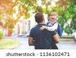 back to school. parent and kid... | Shutterstock . vector #1136102471