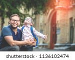 back to school. parent and kid... | Shutterstock . vector #1136102474