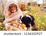 happy kid girl with basket of... | Shutterstock . vector #1136102927