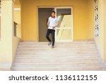 young lover puts headphone...   Shutterstock . vector #1136112155
