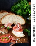 bruschetta with dried jamon ... | Shutterstock . vector #1136114819