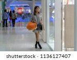 asian woman walking and looking ... | Shutterstock . vector #1136127407