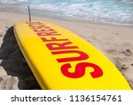 Yellow And Red Surfboard Of...