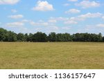 meadow with wide view of a... | Shutterstock . vector #1136157647