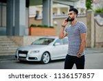 handsome tall arabian beard man ... | Shutterstock . vector #1136157857
