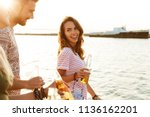 picture of happy young friends... | Shutterstock . vector #1136162201
