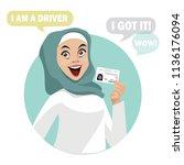 happy shopper. the girl holds... | Shutterstock .eps vector #1136176094