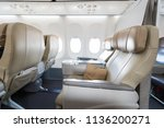 empty leather seats in row... | Shutterstock . vector #1136200271