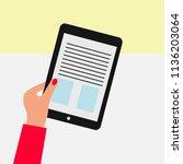 vector hand holding tabet flat... | Shutterstock .eps vector #1136203064