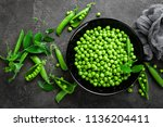 green peas with pods and leaves | Shutterstock . vector #1136204411