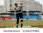 shot put back woman athlete... | Shutterstock . vector #1136219381