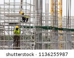 asian construction workers... | Shutterstock . vector #1136255987