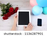 hand hold tablet and touching...   Shutterstock . vector #1136287901