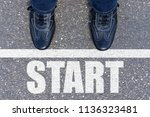 black shoes standing at the... | Shutterstock . vector #1136323481