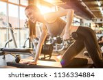 smiling fit girl in sportswear... | Shutterstock . vector #1136334884