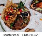 steak pork roasted with... | Shutterstock . vector #1136341364