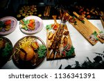 fried pork meat on skewers | Shutterstock . vector #1136341391