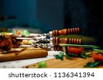fried pork meat on skewers | Shutterstock . vector #1136341394