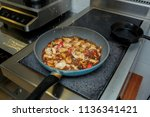 in the frying pan the cook... | Shutterstock . vector #1136341421
