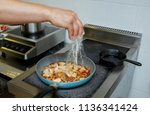 in the frying pan the cook... | Shutterstock . vector #1136341424