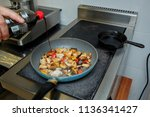 in the frying pan the cook... | Shutterstock . vector #1136341427