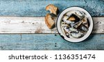 shellfish mussels clams with... | Shutterstock . vector #1136351474