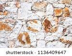 the wall made of sandstones   Shutterstock . vector #1136409647