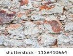 the wall made of sandstones   Shutterstock . vector #1136410664
