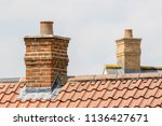 Brick chimney stack on modern...