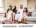 happy arabian family having fun ... | Shutterstock . vector #1136439587