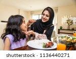 happy arabian family having fun ... | Shutterstock . vector #1136440271