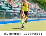 young hockey player woman with... | Shutterstock . vector #1136445881