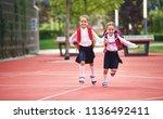 happy children girls girlfriend ... | Shutterstock . vector #1136492411