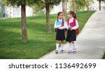 happy children girls girlfriend ... | Shutterstock . vector #1136492699