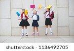 happy children girls girlfriend ... | Shutterstock . vector #1136492705