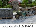 iron wheelbarrow. stack of gray ...   Shutterstock . vector #1136518451