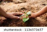 saving earth concept  kid and... | Shutterstock . vector #1136573657