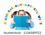 happy preschool child learning... | Shutterstock . vector #1136589521
