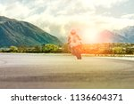 man riding motorcycle on... | Shutterstock . vector #1136604371