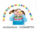 happy preschool child learning... | Shutterstock . vector #1136608754