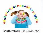 happy preschool child learning... | Shutterstock . vector #1136608754