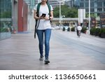 young woman walking with mobile ... | Shutterstock . vector #1136650661
