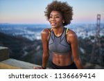 fit african woman woman resting ... | Shutterstock . vector #1136669414