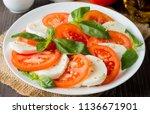 close up photo of caprese salad ... | Shutterstock . vector #1136671901