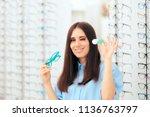 woman choosing between glasses... | Shutterstock . vector #1136763797