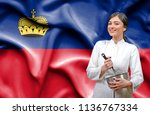 female chef against national... | Shutterstock . vector #1136767334