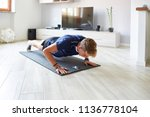 man doing push up at home with... | Shutterstock . vector #1136778104