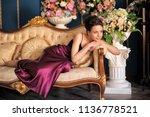 beautiful girl in a purple... | Shutterstock . vector #1136778521