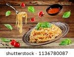 flying pasta with marinara... | Shutterstock . vector #1136780087